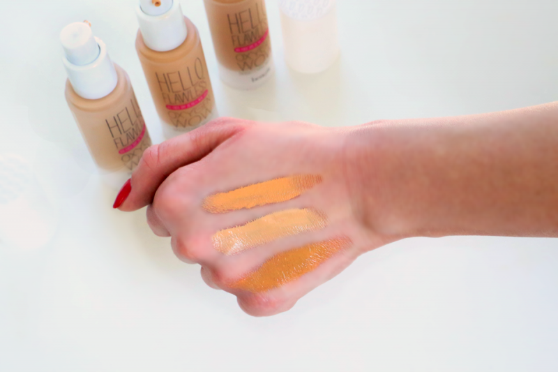 Different shades of Benefit Foundation swatches on hand