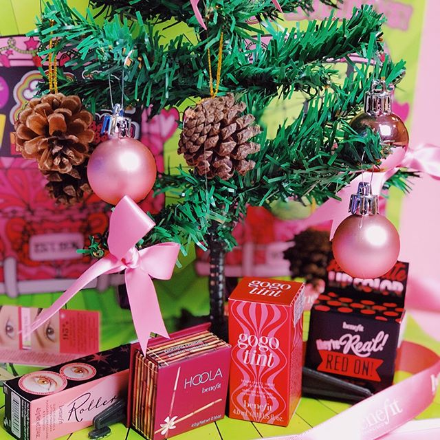 Christmas tree with Benefit products around it