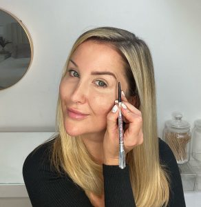 Model applying Benefit Cosmetics Precisely, My Brow