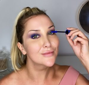 Lauren using BADgal BANG mascara in blue