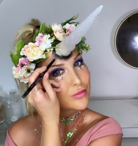 Lauren using the badgal bang 24 hour eye pencil